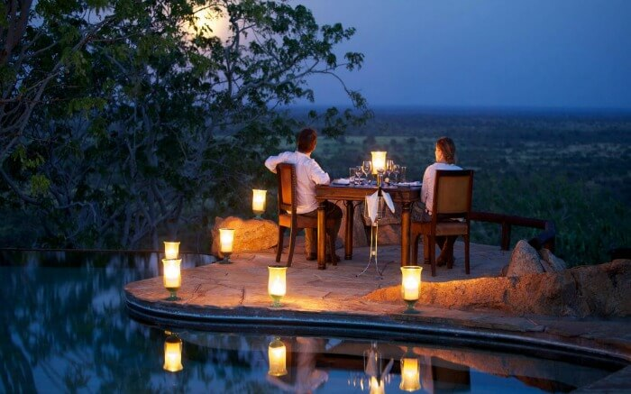 Couple watching the sunset during a safari honeymoon in South Africa ss29052017