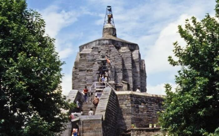 Devotees climbing stairs leading to the top of Shankaracharya temple in Kashmir