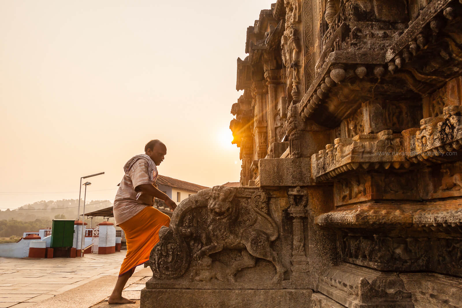 An old man climbing the stairs of Gopalakrishna Temple