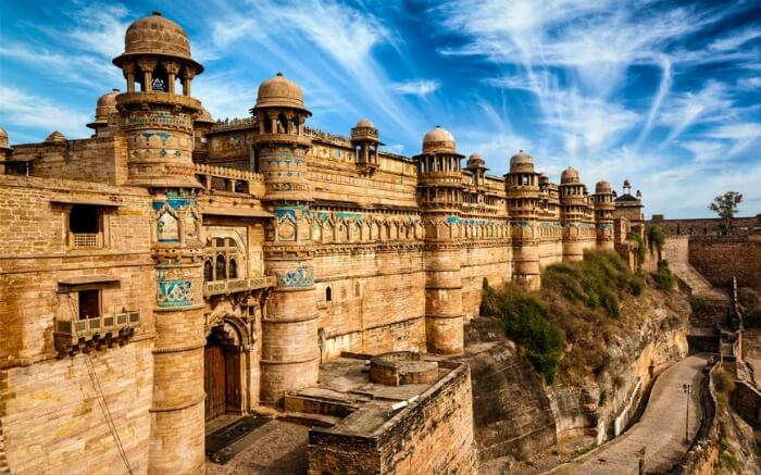 Gwalior Fort under a cloudy sky