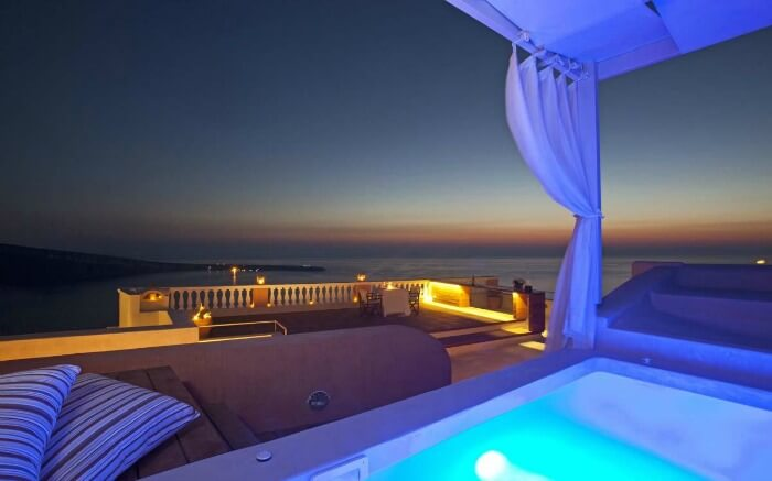 Luxury Jacuzzi pool at terrace of Oia Mansion at night
