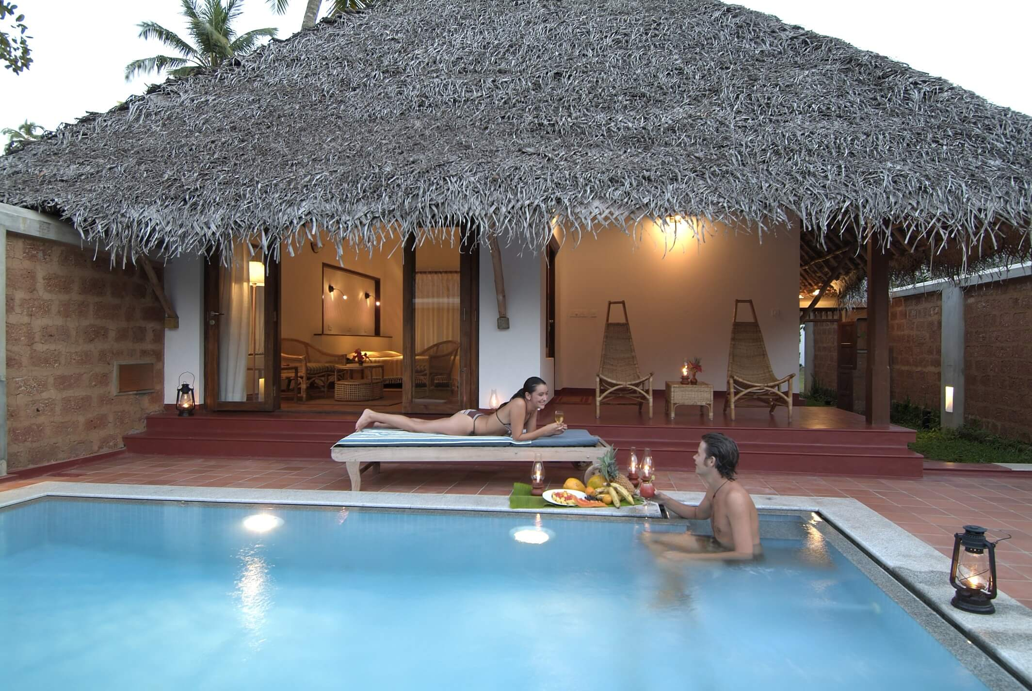 a couple swimming in a private pool of Marari Villa