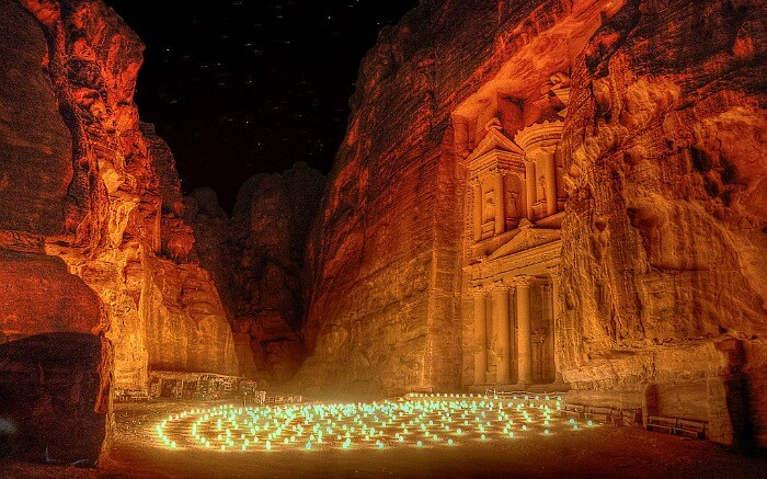 Petra illuminated by candles at night