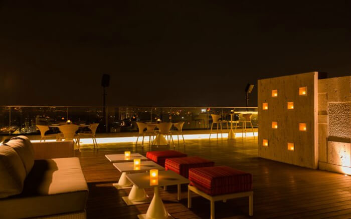 Rooftop dining area of Evviva Sky Lounge in Crowne Plaza Pune