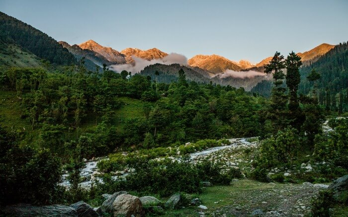 The secluded environs of Chatpal surrounded by mountains and forests on a beautiful day