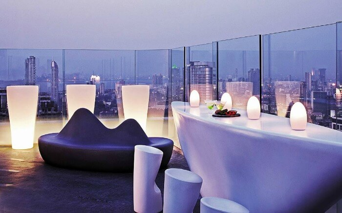 Well lit dining space atop the roof at Aer Four Seasons Mumbai