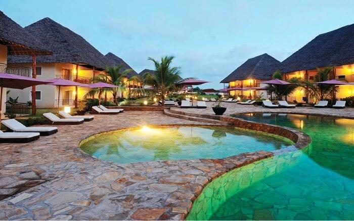 a Zanzibari thatched roof villas in a resort
