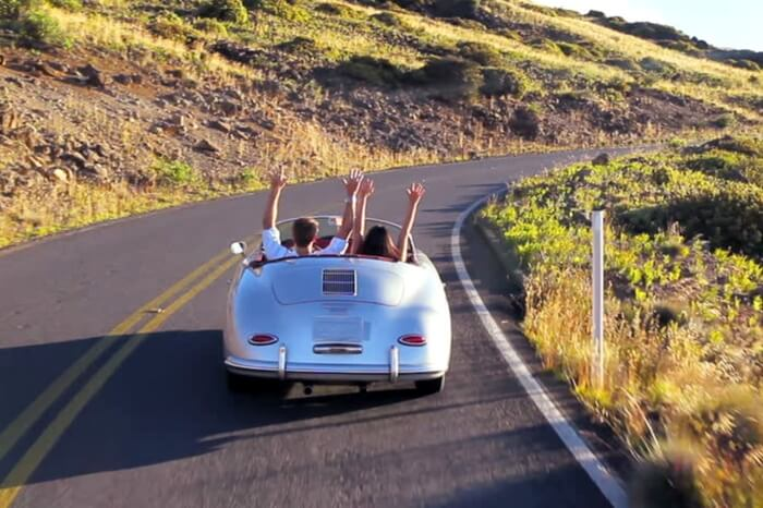 Couple taking a romantic drive in a classic car