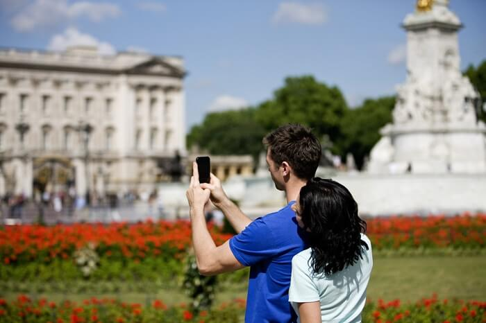 couple clicking picture of a palace london