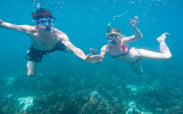 couple snorkelling at Mnemba Atoll