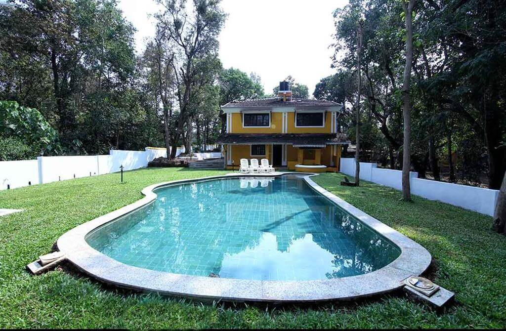 a private pool in front of a villa in Goa