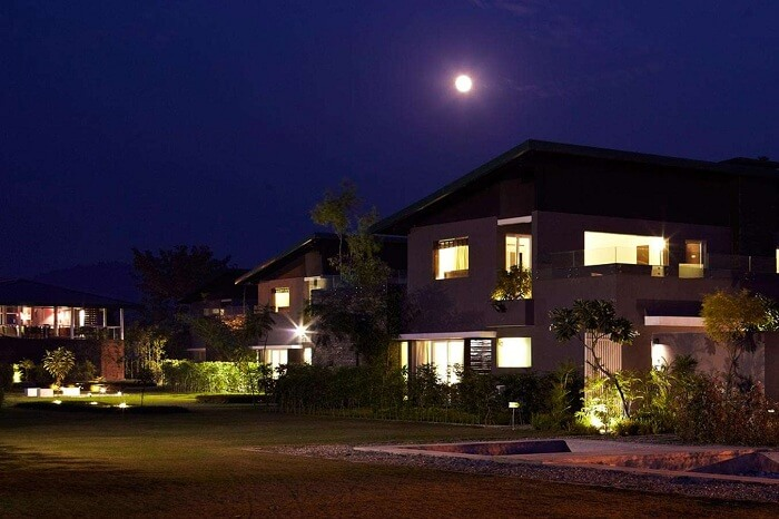 A snap of the luxe cottages of Aalia On The Ganges resort at night