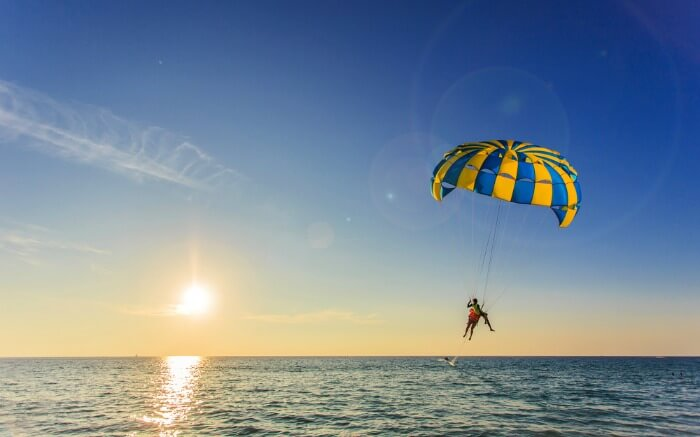 parasailing over an ocean