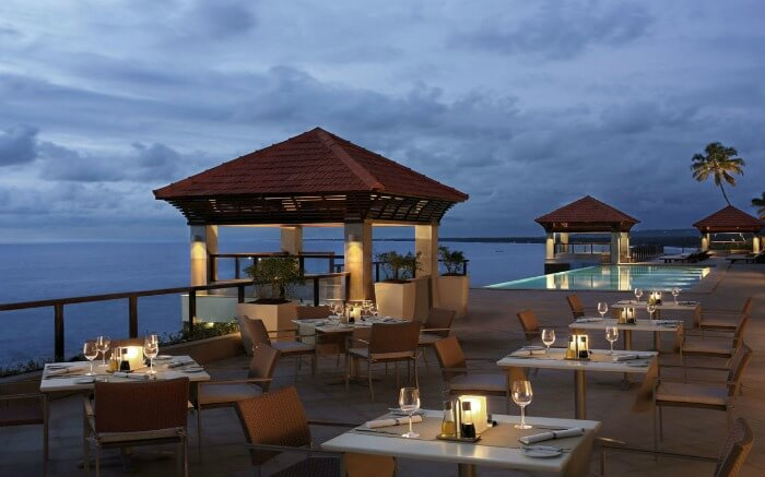 romantic dinner at a rooftop restaurant in The Leela Kovalam