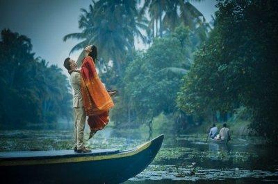 a honeymoon couple on a boat in Kerala