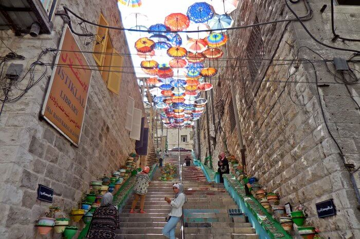 Rainbow Street in Amman decorated with colourful umbrellas