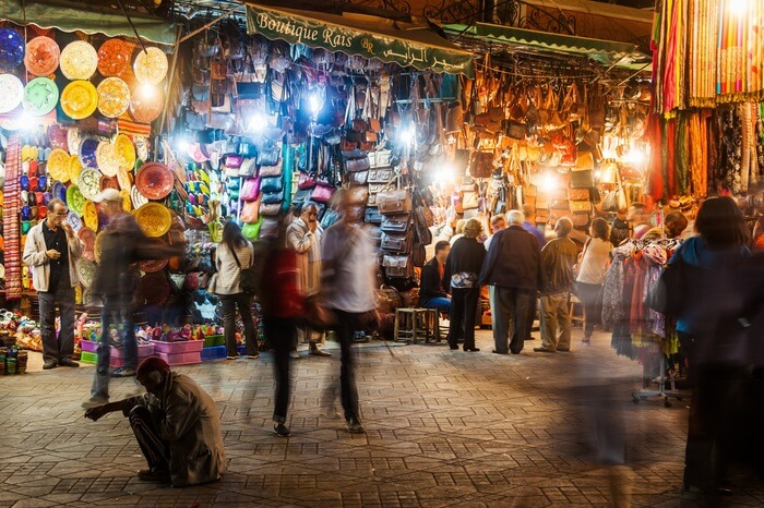A couple walking through the night markets of Marrakech in Morocco