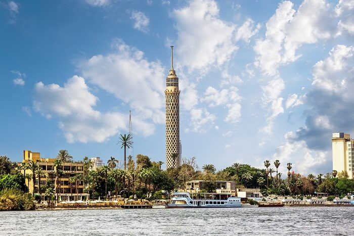 A cruise on the Nile River passing by the Cairo tower in Egypt