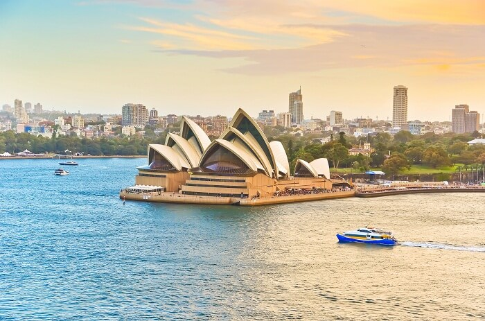 Ferries passing by the Sydney Opera House in Australia