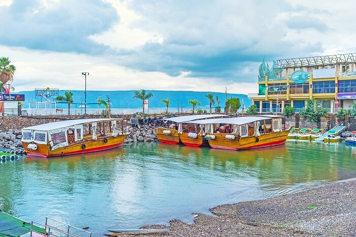 The wooden pleasure boats in harbor on the Kinneret Lake of Tiberias in Israel