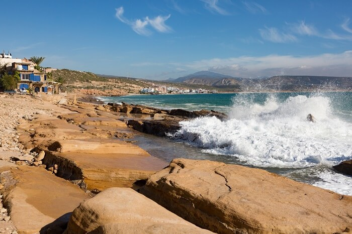Ocean waves splashing against the rocks near Taghazout to the north of Agadir in Morocco
