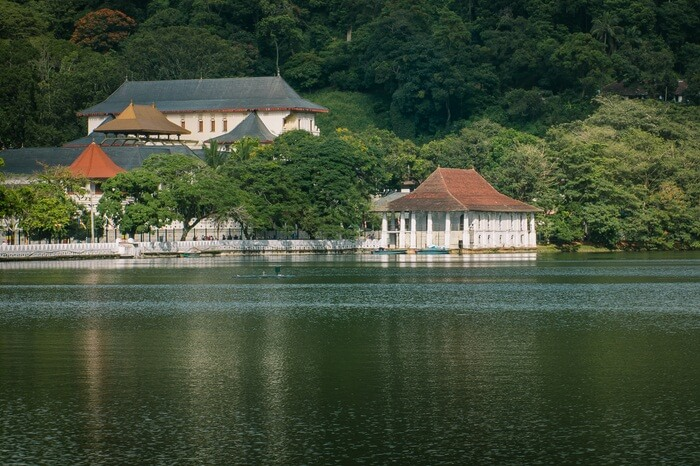 A shot of the Temple of Tooth Relic and the Kandy Lake in Sri Lanka