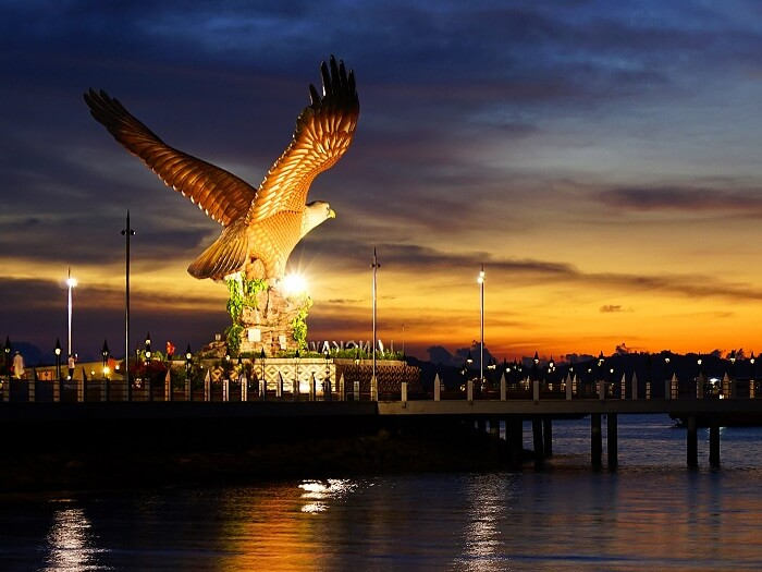 A late evening shot of the iconic Eagle statue by the sea in Langkawi