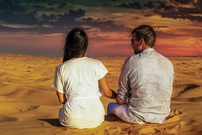 A couple enjoying sunset in the desert