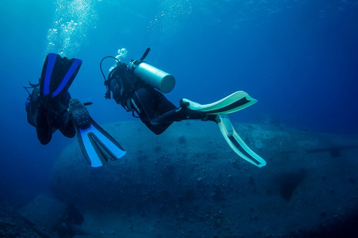A couple exploring the shipwreck site at Aqaba in Jordan