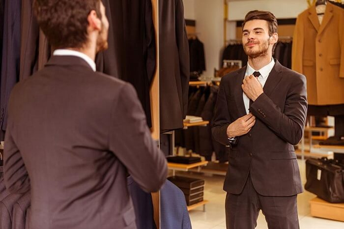 man trying wedding outfit