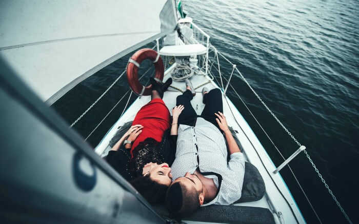 A couple relaxing while sailing