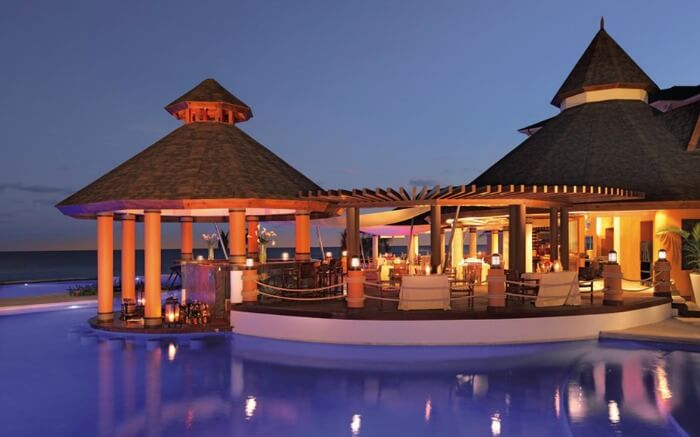 A hutlike resort in Jamaica at night