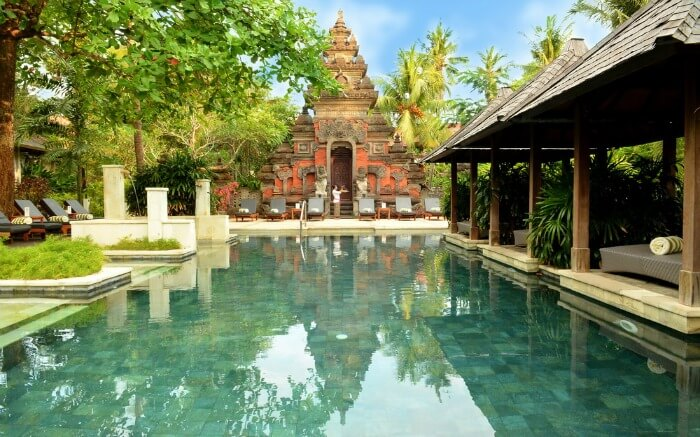 An Indonesian temple near a swimming pool in a resort