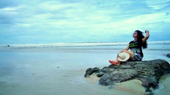 posing on candolem beach