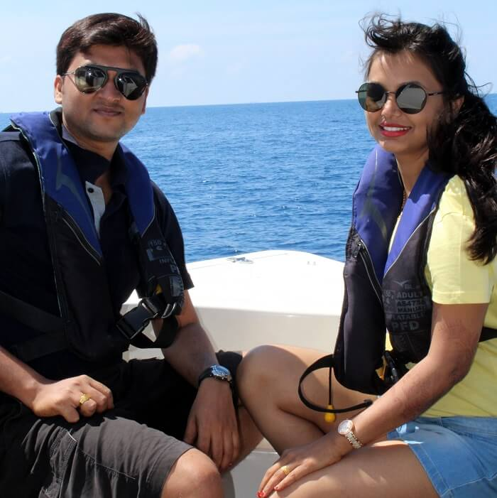 couple in motorboat maldives