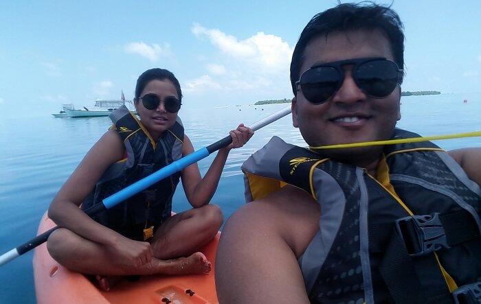 couple doing kayaking in maldives