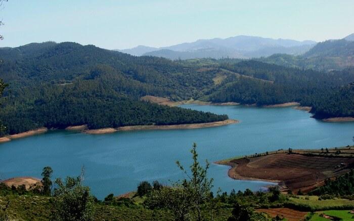 Emerald Dam and Lake meandering through Nilgiri mountains