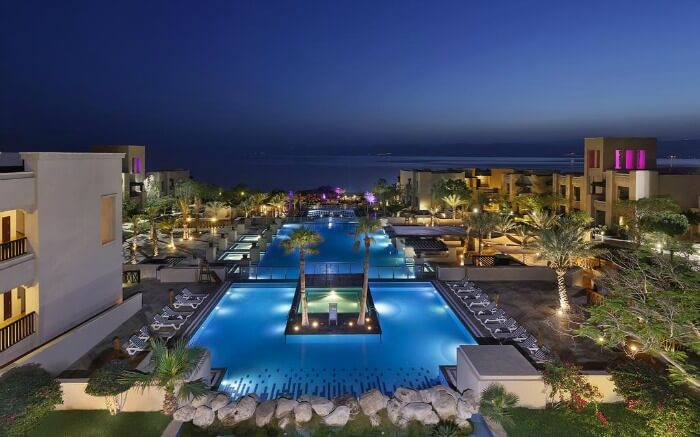Glowing outdoor pools in a resort near Dead Sea