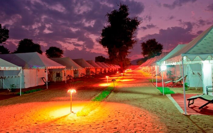 Luxurious camps in desert lit at night