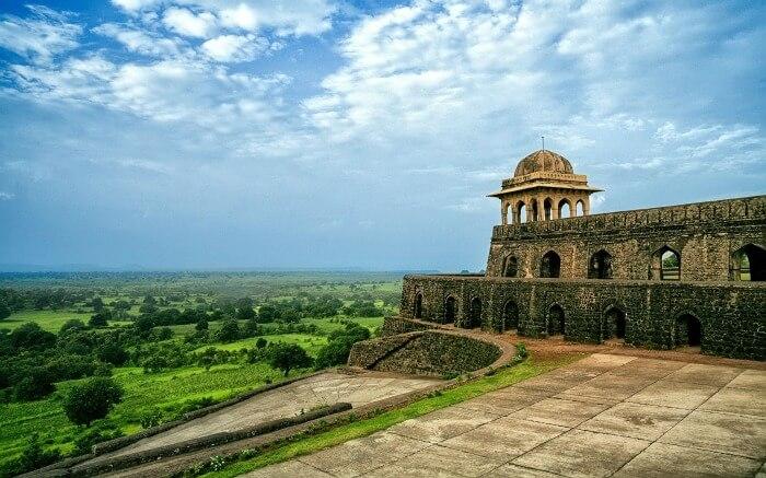 Mandu Fort overlooking a lush green field