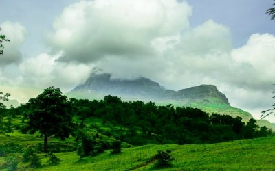 Purshwadis green landscapes around the hillocks covered in clouds