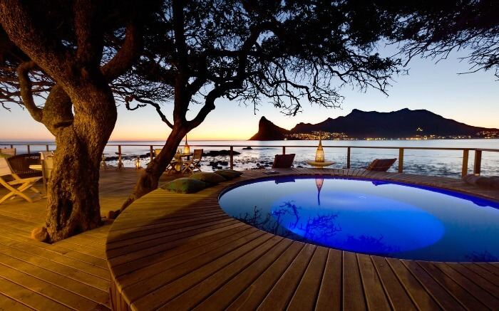The deck view of a romantic pool close to the Atlantic Ocean in South Africa