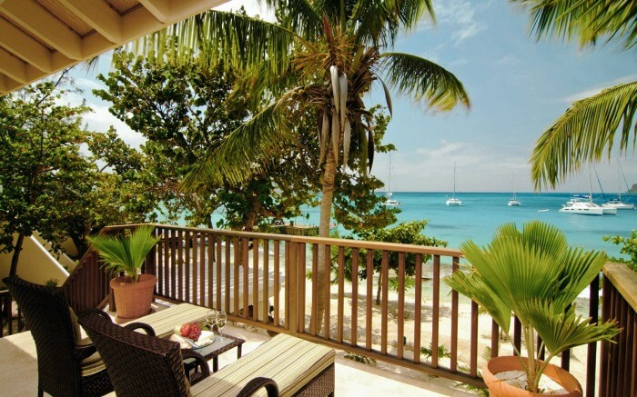 a balcony of a resort overlooking the sea