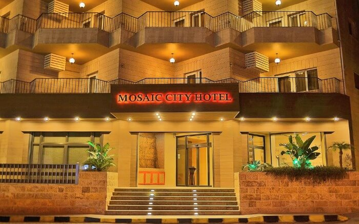 a beautiful hotel building well lit at night