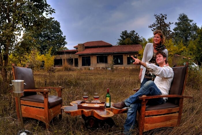 Couple at the private seating space of King's Lodge in Bandhavgarh