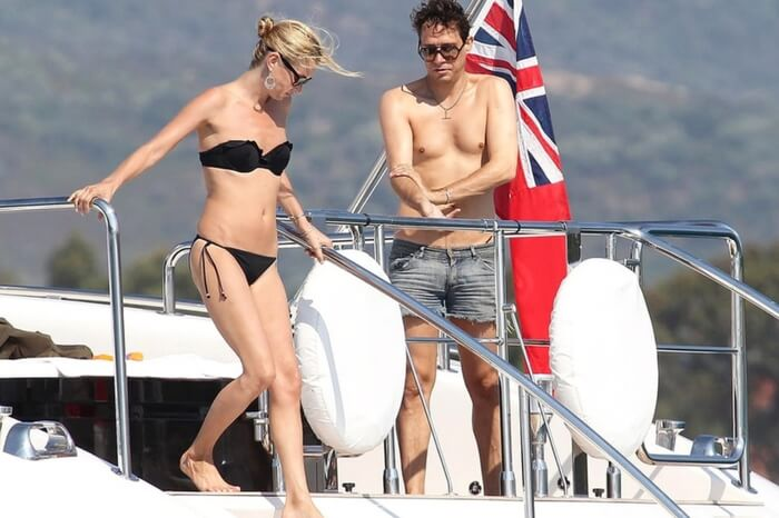 Kate Moss with her husband coming down from her yacht while on a honeymoon in Corsica