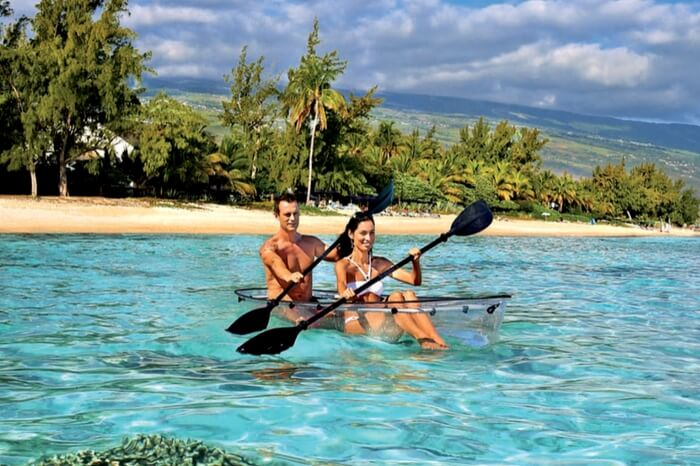 Couple kayaking in a glass boat at Reunion Island