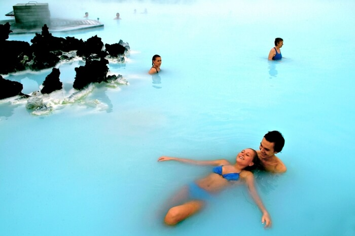 Couple enjoying romantic moments in a lagoon in Iceland