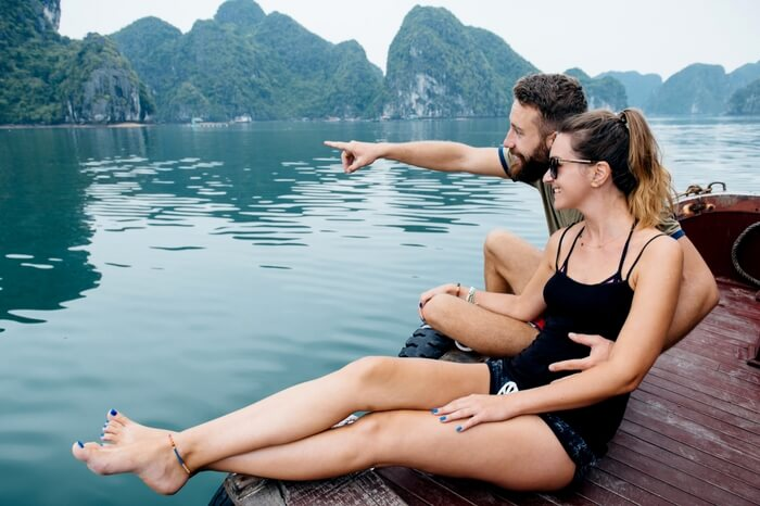 Couple relaxing on a boat in Vietnam