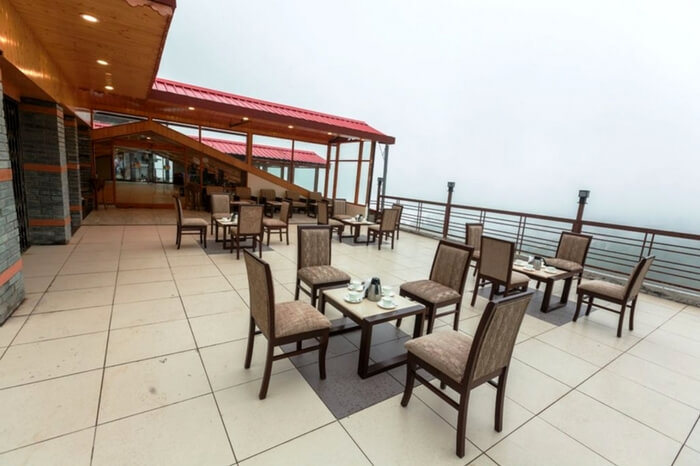 Rooftop dining space of Snow Valley Resort in Shimla